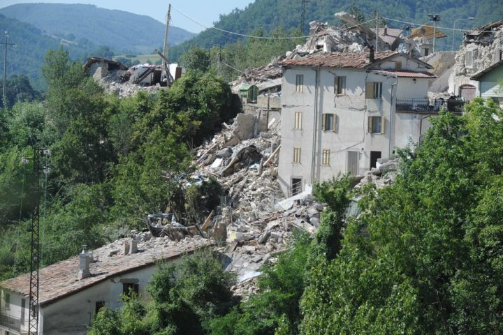 2016-08-25 09:34:26 Damaged houses are pictured in Pescara del Tronto on August 25, 2016, a day after a 6.2-magnitude earthquake struck the region killing some 247 people. The death toll from a powerful earthquake in central Italy rose to 247 on August 25, 2016 amid fears many more corpses would be found in the rubble of devastated mountain villages. Rescuers sifted through collapsed masonry in the search for survivors, but their grim mission was clouded by uncertainty about exactly how many people had been staying in communities closest to the epicentre of the quake of August 24. / AFP PHOTO / MARCO ZEPPETELLA
