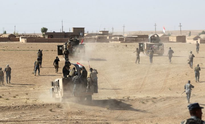 "2016-10-18 13:51:02 Iraqi forces deploy in the Bajwaniyah village, about 30 kms south of Mosul, on October 18, 2016 after they liberated it from Islamic State (IS) group jihadists. Tens of thousands of Iraqi forces were making gains on the Islamic State group in Mosul in an offensive US President Barack Obama warned would be a ""difficult fight"". / AFP PHOTO / AHMAD AL-RUBAYE"