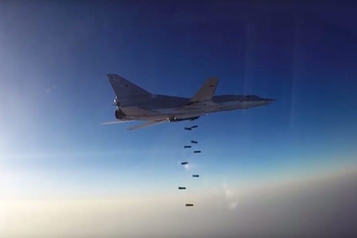 2016-08-16 00:00:00 epa05489363 A handout still image, grabbed from a Russian Defense Ministry video footage that was issued 16 August 2016, showing a Tu-22M3 long-range bomber releasing its payload above Syria after it took off from the Hamedan air base in the Islamic Republic of Iran while carrying out airstrikes on IS and Jabhat al-Nusra terrorist groups in the provinces of Aleppo, Deir ez-Zor and Idlib. Russia also used Su-34 tactical bombers to attack the insurgents. It was the first time Russia has used an Iranian air base in such operation. EPA/RUSSIAN DEFENSE MINISTRY / HANDOUT HANDOUT EDITORIAL USE ONLY/NO SALES