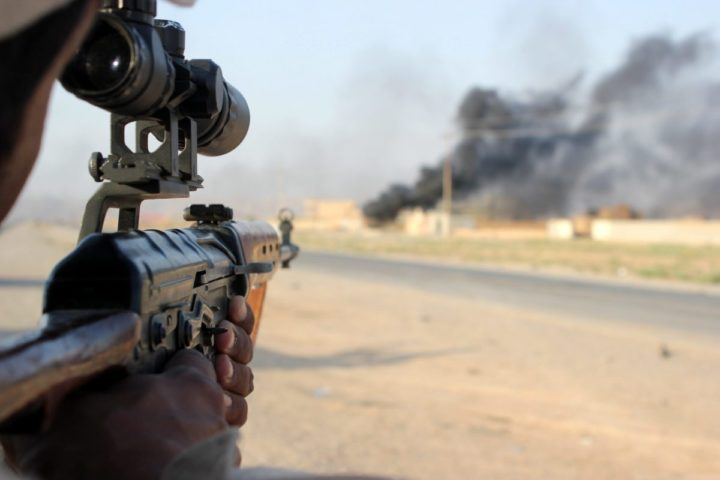 2014-09-01 20:00:00 epa04380040 A member of the Iraqi Shiite militia, Kataib Hezbollah (Hezbollah Brigades), aims his rifle during fighting against Islamic State (IS) fighters, in Amerli town, northeastern Baghdad, Iraq, 01 September 2014. Iraqi government and Kurdish forces on 01 September retook two more towns from the militant Islamic State organization, officials said, building on recent gains against the radical jihadists. Government troops, backed by Shiite militiamen and Kurdish Peshmerga forces, recaptured the northern town of Suleiman Pek and Amerli towns, an official said. EPA/STR