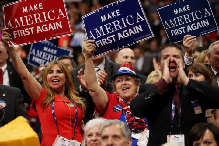 """2016-07-20 00:00:00 CLEVELAND, OH - JULY 20: Delegates hold up signs that read """"Make America First Again"""" during the opening of the third day of the Republican National Convention on July 20, 2016 at the Quicken Loans Arena in Cleveland, Ohio. Republican presidential candidate Donald Trump received the number of votes needed to secure the party's nomination. An estimated 50,000 people are expected in Cleveland, including hundreds of protesters and members of the media. The four-day Republican National Convention kicked off on July 18. Joe Raedle/Getty Images/AFP == FOR NEWSPAPERS, INTERNET, TELCOS & TELEVISION USE ONLY =="""