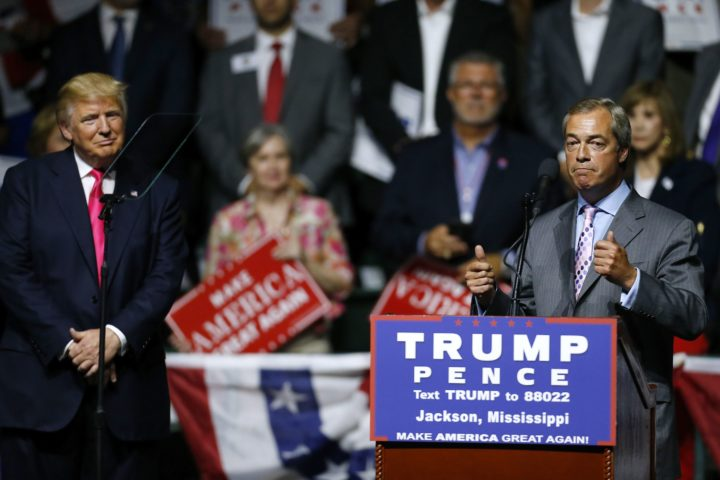 2016-08-24 00:00:00 JACKSON, MS - AUGUST 24: Republican Presidential nominee Donald Trump, left, listens to United Kingdom Independence Party leader Nigel Farage speak during a campaign rally at the Mississippi Coliseum on August 24, 2016 in Jackson, Mississippi. Thousands attended to listen to Trump's address in the traditionally conservative state of Mississippi. Jonathan Bachman/Getty Images/AFP == FOR NEWSPAPERS, INTERNET, TELCOS & TELEVISION USE ONLY ==
