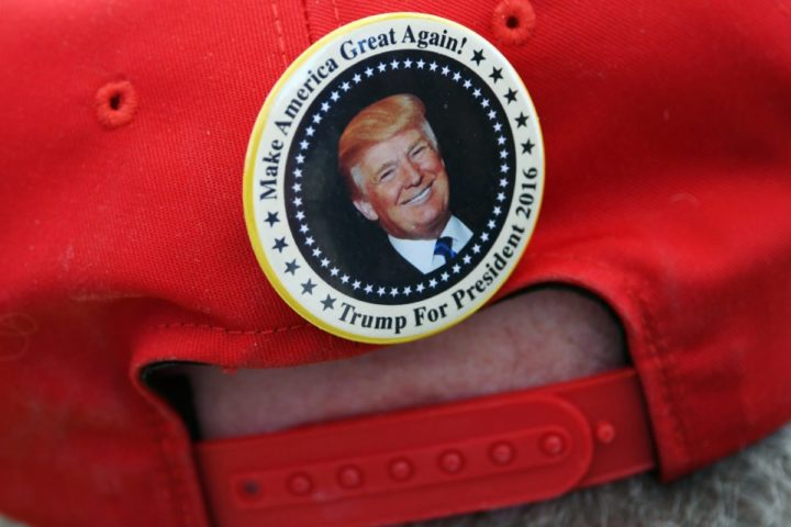 2016-10-05 00:00:00 HENDERSON, NV - OCTOBER 05: A supporter of Republican presidential nominee Donald Trump wears a hat with a campaign button on the back of it during a campaign rally at the Henderson Pavilion on October 5, 2016 in Henderson, Nevada. Trump is campaigning ahead of the second presidential debate coming up on October 9 with Democratic presidential nominee Hillary Clinton. Ethan Miller/Getty Images/AFP == FOR NEWSPAPERS, INTERNET, TELCOS & TELEVISION USE ONLY ==