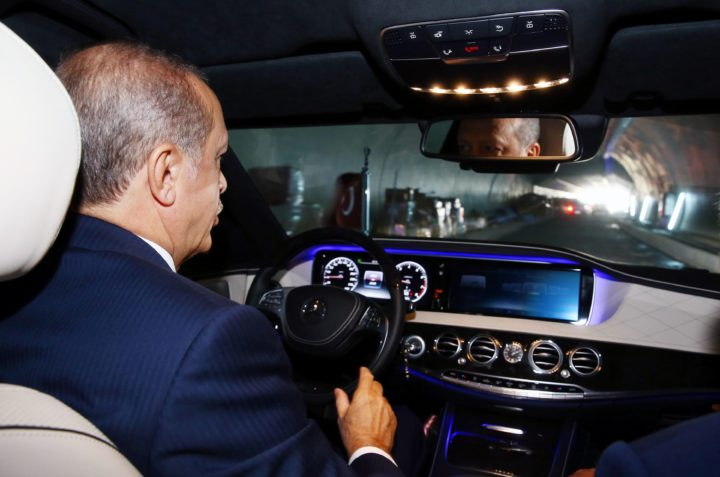 "2016-10-08 12:34:48 This handout picture taken and realesed by the Turkish Presidency Press Service on October 8, 2016 in Istanbul shows Turkey's President Recep Tayyip Erdogan driving a car through Euroasia tunnel during a visit to the construction site for first test drives. The government's other grandiose projects for the city include the Eurasia tunnel -- a road passage underneath the Bosphorus -- expected to be inaugurated on December 20. / AFP PHOTO / TURKISH PRESIDENCY PRESS OFFICE / KAYHAN OZER / RESTRICTED TO EDITORIAL USE - MANDATORY CREDIT ""AFP PHOTO / TURKISH PRESIDENTIAL PRESS OFFICE /KAYHAN OZER "" - NO MARKETING - NO ADVERTISING CAMPAIGNS - DISTRIBUTED AS A SERVICE TO CLIENTS"