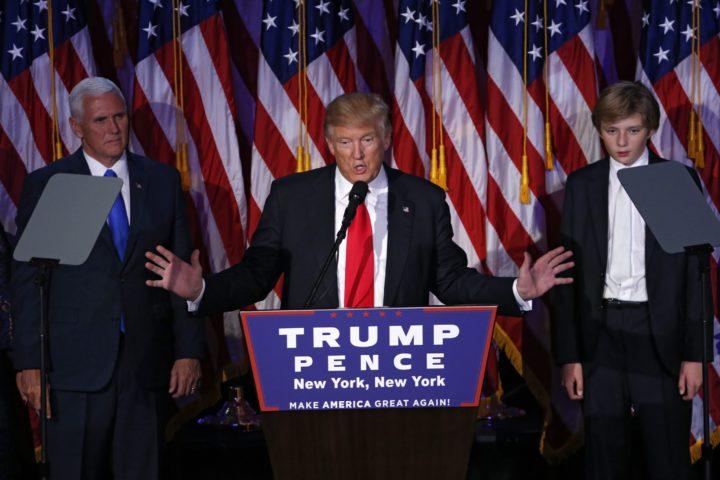 2016-11-09 03:49:57 epa05623717 US Republican presidential nominee Donald Trump (C) delivers a speech on stage at Donald Trump's 2016 US presidential Election Night event as votes continue to be counted at the New York Hilton Midtown in New York, New York, USA, 08 November 2016. EPA/SHAWN THEW