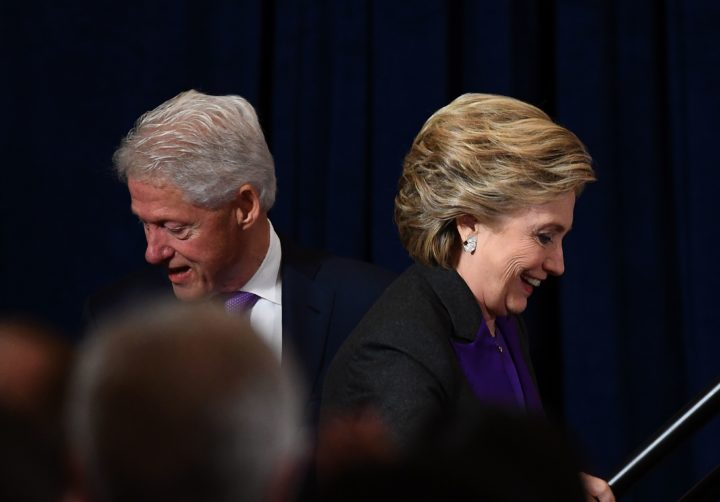 2016-11-09 16:40:13 US Democratic presidential candidate Hillary Clinton is accompanied by her husband and former president Bill Clinton as she arrives to make a concession speech after being defeated by Republican presidential-elect Donald Trump, in New York on November 9, 2016. / AFP PHOTO / JEWEL SAMAD