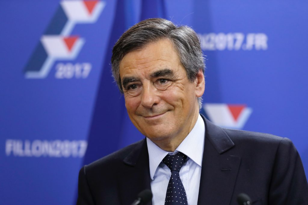 2016-11-20 23:44:50 Candidate for the right-wing Les Republicains (LR) party primaries ahead of the 2017 presidential election and former French prime minister, Francois Fillon reacts at his campaign headquarters after finishing first of the first round of the rightwing presidential primary, on November 20, 2016 in Paris. / AFP PHOTO / POOL / Thomas SAMSON