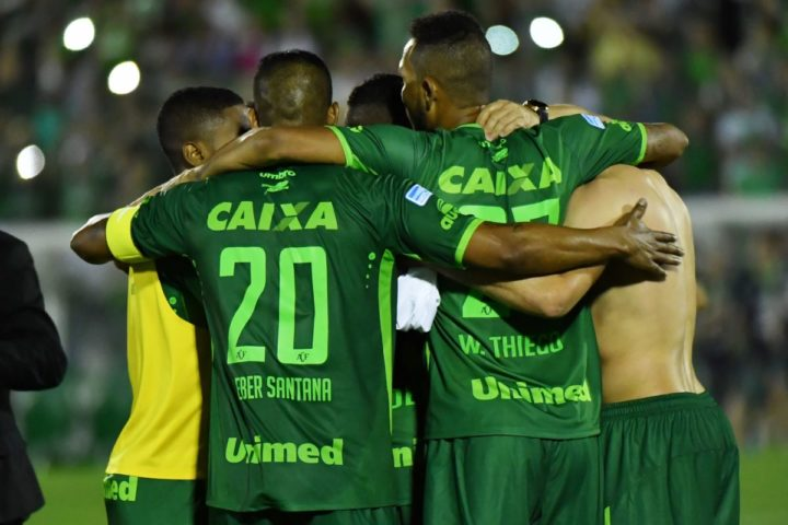 2016-11-23 23:54:02 Brazil's Chapecoense footballers celebrate after defeating Argentina's San Lorenzo during their 2016 Copa Sudamericana their 2016 Copa Sudamericana semifinal second leg football match held at Arena Conda stadium, in Chapeco, Brazil, on November 23, 2016. / AFP PHOTO / NELSON ALMEIDA