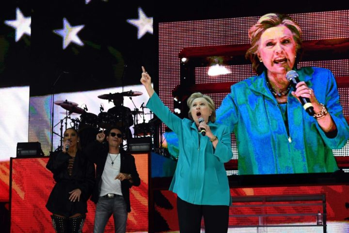 "2016-10-29 19:52:34 US Democratic presidential nominee Hillary Clinton speaks as singer Jennifer Lopez and Marc Anthony look on during ""Go Out to Vote"" concert at the Bayfront Park Amphitheater in Miami, Florida, on October 29, 2016. Clinton embarks this weekend on the frenetic final 10 days of her White House campaign, determined to shake off renewed controversy over the FBI probe into her private emails. The 69-year-old Democrat -- vying to become America's first female president -- is still the frontrunner to win the November 8 election over her Republican rival Donald Trump. / AFP PHOTO / Jewel SAMAD"