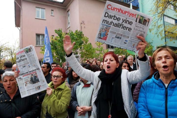 2016-10-31 16:03:27 Readers shout slogans and hold the latest copy of Turkish newspaper Cumhuriyet outside its headquarters in Ankara on October 31, 2016, during a protest against the detention of the editor-in-chief and a dozen journalists and executives. Turkish police on October 31 detained Murat Sabuncu, the editor-in-chief of the newspaper -- a thorn in the side of President Recep Tayyip Erdogan -- as Ankara widens a crackdown on opposition media. The newspaper, which had published revelations embarrassing for the government, said at least a dozen journalists and executives were detained in early morning raids. The detentions come after Turkish authorities fired more than 10,000 civil servants at the weekend and closed 15 pro-Kurdish and other media outlets, the latest purge since July's failed military coup. / AFP PHOTO / ADEM ALTAN