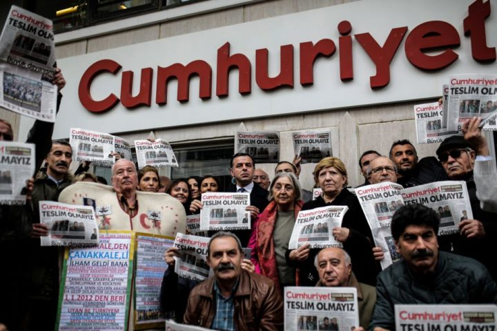"2016-11-01 21:57:43 Protesters hold copies of the latest edition of the Turkish daily newspaper ""Cumhuriyet"" during a demonstration in support to the Cumhuriyet in front of its headquarters in Istanbul on November 1, 2016. Turkish police on October 31, 2016, detained the editor-in-chief of the newspaper Cumhuriyet -- a thorn in the side of President Recep Tayyip Erdogan -- as Ankara widens a crackdown on opposition media. The Cumhuriyet, which had published revelations embarrassing for the government, said at least a dozen journalists and executives were detained in early morning raids. Murat Sabuncu was detained while authorities searched for executive board chairman Akin Atalay and writer Guray Oz, the official news agency Anadolu said. / AFP PHOTO / YASIN AKGUL"