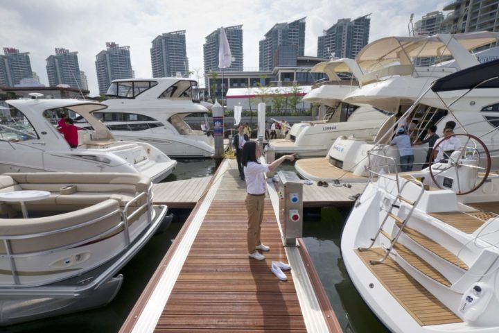 epa02663869 A visitor walks on as yachts from around the world are on show at the 'Hainan Rendezvous 2011' luxury lifestyle show aimed at China's new class of super rich in Sanya, Hainan, China, 01 April 2011. All kinds of luxury goods from Rolls Royces and Ferraris to 170 foot yachts as well as property agents from Monaco and French wine dealers were looking to attract China's millionaires and billionaires. Hainan Rendezvous 2011 runs until 04 April 2011. EPA/ADRIAN BRADSHAW