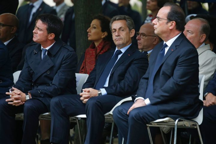 2016-09-19 11:37:06 French Prime Minister Manuel Valls (L), former French President Nicolas Sarkozy (C) and French President Francois Hollande attend a France's national tribute to victims of terrorism at the Hotel des Invalides in Paris on September 19, 2016. / AFP PHOTO / POOL / JACKY NAEGELEN