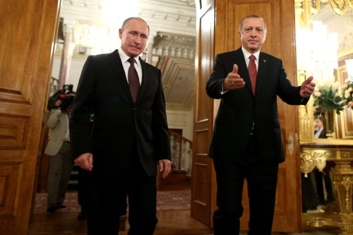 2016-10-10 20:38:28 epa05580041 Russian President Vladimir Putin (L) and Turkey's President Recep Tayyip Erdogan (R) arrive for their meeting on the sidelines of the 23rd World Energy Congress, in Istanbul, Turkey, 10 October 2016. EPA/TOLGA BOZOGLU