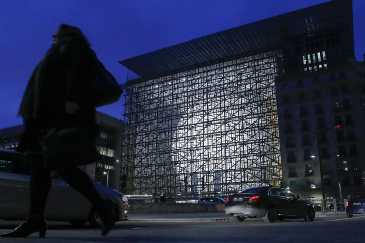 2016-12-08 04:00:26 epa05665151 People walk past the Europa building in Brussels, Belgium, 08 December 2016. Europa will open its doors to the public on 10 December 2016. Almost 2,000 citizens have registered for a guided tour of the building, which will serve mainly the European Council and occasionally the Council of the European Union as a summit building. EPA/OLIVIER HOSLET