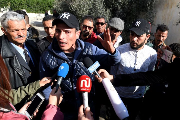 2016-12-22 12:36:46 Walid (L) and Abdelkader(2nd R) Amri, the brothers of 24-year-old Anis Amri, the prime suspect in Berlin's deadly truck attack, talk to the media in front of their family house in the town of Oueslatia, in Tunisia's region of Kairouan on December 22, 2016. German authorities came under fire after it emerged that the prime suspect in Berlin's deadly truck attack, a rejected Tunisian asylum seeker, was known as a potentially dangerous jihadist. / AFP PHOTO / FETHI BELAID