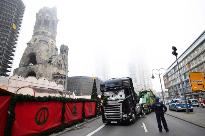 "2016-12-20 08:05:44 A truck is towed away on December 20, 2016 as forensic experts examine the scene around a truck that crashed into a Christmas market near the Kaiser-Wilhelm-Gedaechtniskirche (Kaiser Wilhelm Memorial Church) in Berlin. German police said they were treating as ""a probable terrorist attack"" the killing of 12 people when the speeding lorry cut a bloody swath through the packed Berlin Christmas market. / AFP PHOTO / Tobias SCHWARZ"