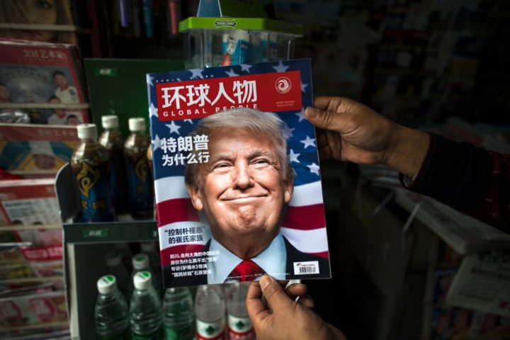 """2016-11-14 14:16:19 TOPSHOT - A copy of the local Chinese magazine Global People with a cover story that translates to """"Why did Trump win"""" is seen with a front cover portrait of US president-elect Donald Trump at a news stand in Shanghai on November 14, 2016. Chinese President Xi Jinping and US president-elect Donald Trump agreed November 14 to meet """"at an early date"""" to discuss the relationship between their two powers, Chinese state broadcaster CCTV said. / AFP PHOTO / JOHANNES EISELE"""