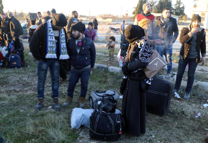 2016-12-15 17:07:32 Syrians, who were evacuated from rebel-held neighbourhoods in the embattled city of Aleppo, arrive in the opposition-controlled Khan al-Aassal region, west of the city, on December 15, 2016, the first stop on their trip, where humanitarian groups will transport the civilians to temporary camps on the outskirts of Idlib and the wounded to field hospitals. Hundreds of civilians and rebels left Aleppo under an evacuation deal that will allow Syria's regime to take full control of the city after years of fighting. / AFP PHOTO / Baraa Al-Halabi