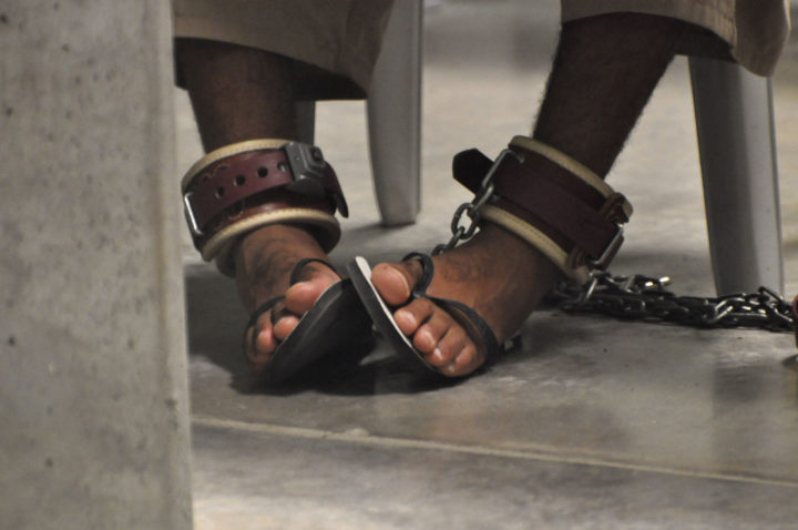 "2010-04-27 21:45:00 In this photo, reviewed by a US Department of Defense official, a Guantanamo detainee's feet are shackled to the floor as he attends a ""Life Skills"" class inside the Camp 6 high-security detention facility at Guantanamo Bay US Naval Base, Cuba, on April 27, 2009. Canadian Guantanamo detainee Omar Khadr facing a US military tribunal for alleged war crimes has reportedly turned down a plea offer that would have meant five years in prison. POOL/Michelle Shephard = IMAGE REVIEWED BY THE US DEPARTMENT OF DEFENSE ="