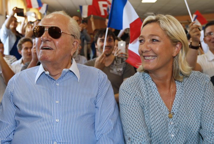 2014-09-07 14:38:03 French far-right leader Marine Le Pen (R) and her father France's former far-right leader Jean-Marie Le Pen attend a youth summer congress of the Front National (FN) far-right party , on september 7, 2014, in Frejus, southern France. AFP PHOTO / VALERY HACHE