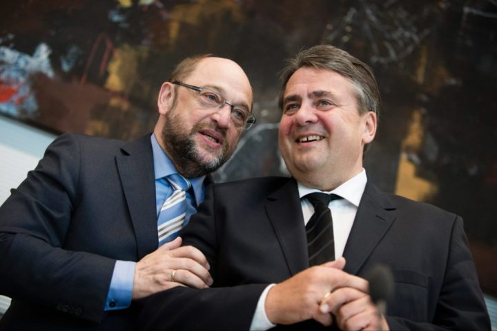 2015-07-16 00:00:00 epa04849328 President of the European Parliament, Martin Schulz (L), and German Economy Minister Sigmar Gabriel (R) talk before the start of a special meeting of the Social Democratic (SPD) parliamentary group on the Greek debt crisis in the Reichstag in Berlin, Germany, 16 July 2015. EPA/GREGOR FISCHER