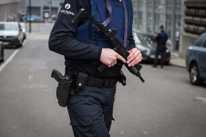 2016-03-19 09:42:08 A Belgian police officer patrols outside the Belgian Federal Police headquarters in Brussels on March 19, 2016. Key Paris attacks suspect Salah Abdeslam and an accomplice on March 19, 2016 left the Brussels hospital where they were treated overnight for gunshot wounds sustained during their arrest, the city mayor said. Both are likely to be questioned before a hearing on their extradition to France in connection with the November attacks on Paris which left 130 people dead. Abdeslam, 26, and four other suspects were arrested on March 18 in the gritty Brussels neighbourhood of Molenbeek. / AFP PHOTO / Belga / Aurore Belot / Belgium OUT