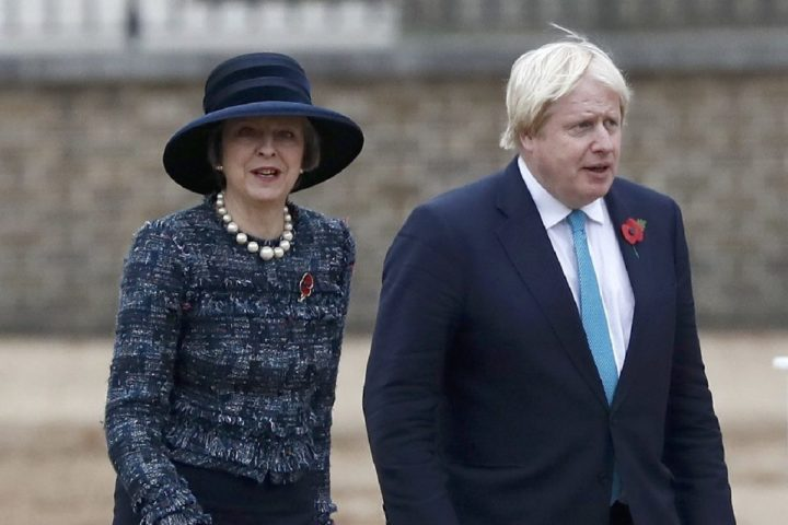 2016-11-01 12:01:11 Britain's Prime Minister Theresa May (L) and British Foreign Secretary Boris Johnson arrive to take part in a ceremonial welcome at Horse Guards Parade for Colombia's President Juan Manuel Santos and his wife Maria Clemencia de Santos in central London, on November 1, 2016. Colombian President Juan Manuel Santos, who won this year's Nobel Peace Prize for his efforts to implement a peace deal with FARC rebels, begins a state visit to Britain that includes a trip to once conflict-ridden Northern Ireland. / AFP PHOTO / POOL / STEFAN WERMUTH