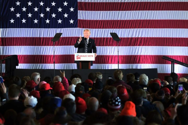 """2016-12-09 15:30:35 US President-elect Donald Trump speaks at a """"get-out-the-vote"""" rally on December 9, 2016 in Baton Rouge, Louisiana. / AFP PHOTO / DON EMMERT"""