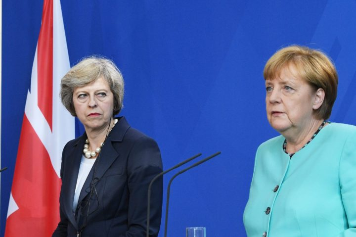 2016-07-20 00:00:00 epa05433683 Britain's new Prime Minister Theresa May (left) casts a glance over at German chancellor Angela Merkel during their joint press conference at the Chancellery in Berlin 20 July 2016 ahead of their 'dinner talks' later this evening. EPA/SOEREN STACHE