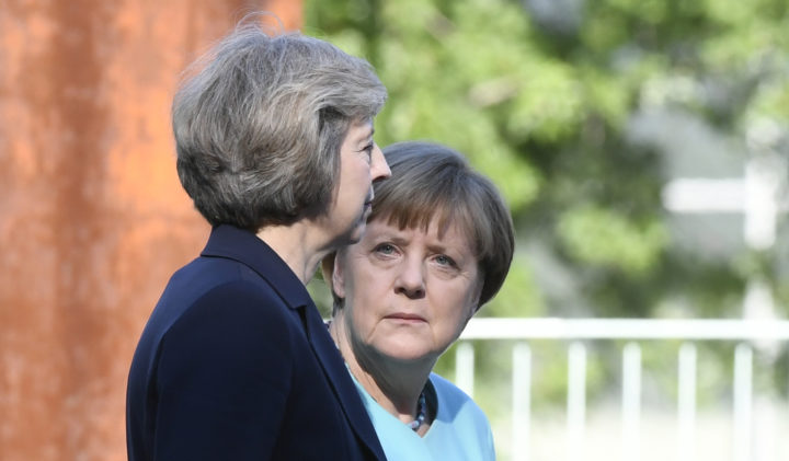 2016-07-20 17:51:05 German Chancellor Angela Merkel (R) and British Prime Minister Theresa May listen to the national anthems on July 20, 2016 during a welcoming ceremony at the chancellery in Berlin. / AFP PHOTO / John MACDOUGALL