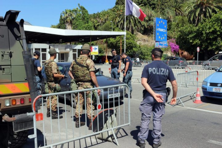 2016-07-15 00:00:00 epa05426074 Italian police and Alpini (Mountain troops) of the Italian Army check vehicles at the border checkpoint between France and Italy, in Ventimiglia, Italy, 15 July 2016. Controlls were tightened at the Italian-French border as a reaction to the Nice truck attack on late 14 July 2016. According to reports, at least 84 people died and many were injured after a truck drove into the crowd on the famous Promenade des Anglais in Nice, France, during celebrations of Bastille Day. Anti-terrorism police took over the investigation in the incident, media added. EPA/LORENZO BALLESTRA