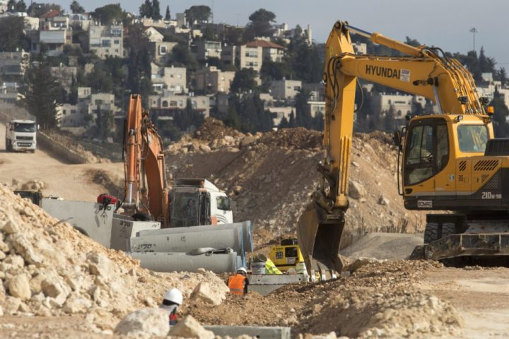2017-01-22 14:09:32 epa05741581 Earth moving equipment building infrastructure in Ramat Shlomo with the French Hill area of Jerusalem seen behind, 22 January 2017. The Jerusalem Municipality has approved the building of some 560 residential housing units some in this religious Jewish community on the northern reaches of Jerusalem and over the 1949 Armistice Line some 48 hours after US President Donald Trump's inauguration. EPA/JIM HOLLANDER