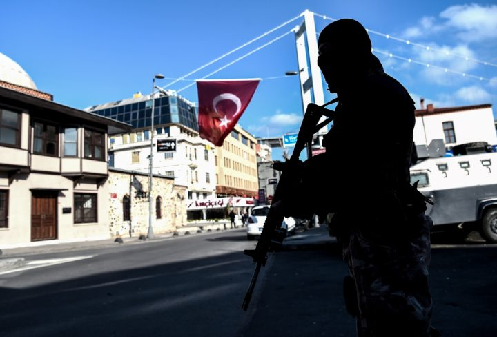 2017-01-02 14:45:45 A Turkish special force police officer stands guard at ortakoy district near the Reina night club, on January 2, 2017 in Istanbul, one day after New Year gun attack. Thirty-nine people were killed early on January 1, 2016 when a gunman went on a rampage at an exclusive nightclub in Istanbul where revellers were celebrating the New Year. / AFP PHOTO / OZAN KOSE