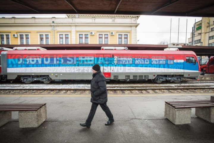 2017-01-14 09:25:34 A man passes a train bound for Kosovo at the main railway station in Belgrade on January 14, 2017. A train from Russia, decorated with the Serbian flag and artwork featuring Serbian churches, monasteries and medieval towns, plans to begin trips traveling from Belgrade to Kosovska Mitrovica, for the first time since the 1998-99 war. / AFP PHOTO / OLIVER BUNIC