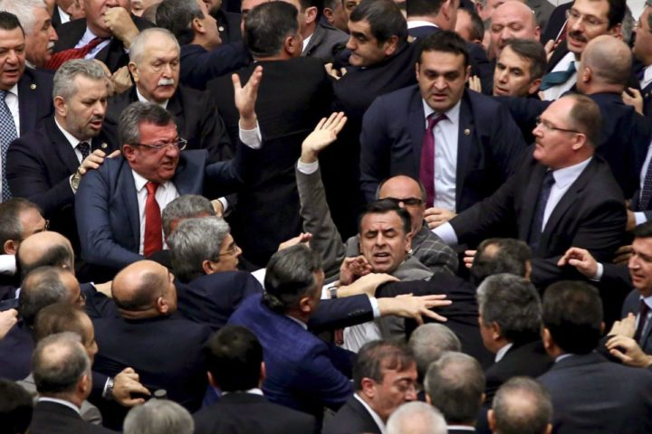 2017-01-11 20:22:24 Ruling Justice and Development Party and main opposition Republican People's Party lawmakers scuffle at the parliament in Ankara during deliberations over a controversial 18-article bill to change the constitution to create an executive presidency January 11, 2017. Turkish lawmakers on Thursday approved three more articles in a hugely controversial bill bolstering the powers of President Recep Tayyip Erdogan, as lawmakers brawled and threw objects in a session of high tension. A brawl erupted in the chamber as the voting took place in an overnight session, with lawmakers punching each another and chairs being thrown, television pictures showed. / AFP PHOTO / -