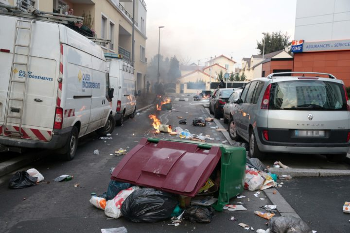 "2017-02-16 18:12:40 This picture taken in Bobigny, northern Paris, on February 16, 2017 shows bins thrown on the road during a demonstration to demand justice for Theo, a 22-year-old youth worker who required surgery after his arrest last week in the gritty suburb of Aulnay-sous-Bois. French President Francois Hollande called for ""justice"" over the alleged rape of a black youth with a police baton, an incident that has sparked 10 nights of rioting and more than 200 arrests. / AFP PHOTO / GEOFFROY VAN DER HASSELT"