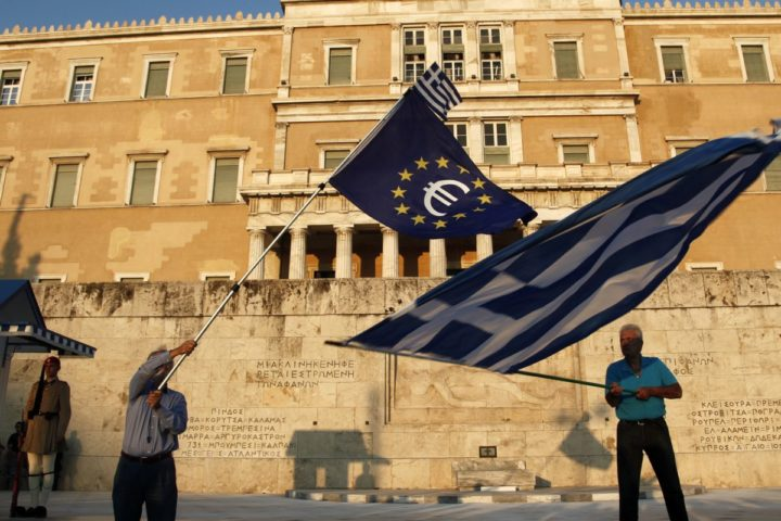 2015-07-09 10:24:19 epa04839461 Demonstrators hold a European and greek flag during a pro euro rally in front of the Greek Parliament in Athens Greece, 09 July 2015. Eurogroup President Jeroen Dijsselbloem on 08 July referred Greece's official request for financial assistance from the European Stability Mechanism (ESM) to the European Central Bank (ECB) and the European Commission. In a letter addressed to European Commissioner for Economic and Monetary Affairs Pierre Moscovici and ECB President Mario Draghi, Dijsselbloem informs them of Greece's request for 'stability support in the form of a loan' and asks them to assess the request under ESM rules. EPA/ALEXANDROS VLACHOS
