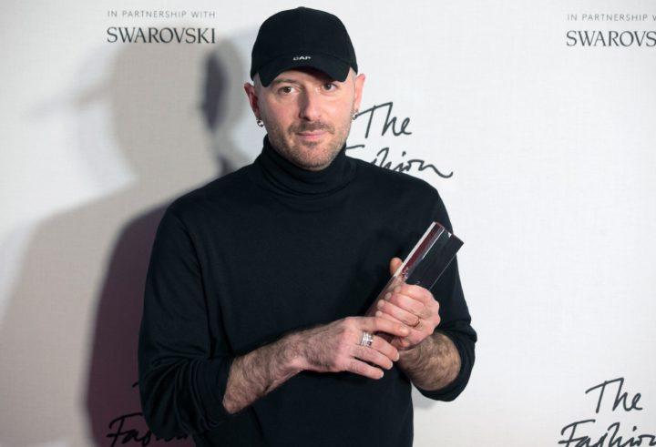 2016-12-05 22:33:17 Designer Demna Gvasalia of fashion house Balenciaga poses with his award after being named winner of the International Ready-to-Wear Designer award during the British Fashion Awards 2016 in London on December 5, 2016. / AFP PHOTO / Daniel LEAL-OLIVAS