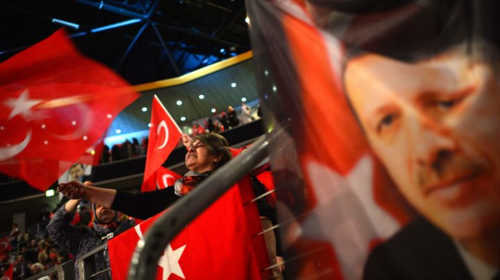 2017-02-18 13:46:54 People wave Turkish flags during a campaigning event with the Turkish Prime Minister in Oberhausen, western Germany, on February 18, 2017. Turkish Prime Minister Binali Yildirim speaks to an expected crowd of some 10,000 people of Turkish origin in Germany to promote support for an April 16, 2017 constitutional referendum on expanding President Recep Tayyip Erdogan's powers. / AFP PHOTO / Sascha Schuermann
