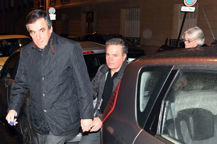 """2017-01-30 22:36:44 French right wing candidate for the upcoming presidential election Francois Fillon (L) and his wife Penelope Fillon (R) accompanied by his bodyguard arrive at their home in the 7th arrondissement in Paris on late January 30, 2017, after their hearing at the anti-corruption police office (OCLCIFF) in Nanterre on allegations that Fillon's wife received half a million euros (USD 540,000) for """"fake jobs"""". / AFP PHOTO / ALAIN JOCARD"""