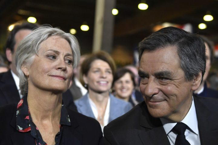 2017-01-29 16:04:06 French right wing candidate for the upcoming presidential election Francois Fillon (R) flanked by his wife Penelope (L), looks on during a campaign rally on January 29, 2017 in Paris. The campaign of Fillon, a former prime minister who won the conservative Republicans' nomination last year, has been dealt a serious blow by claims his Welsh-born spouse did nothing to earn half a million euros ($534,000) paid from public funds over eight years. / AFP PHOTO / Eric FEFERBERG
