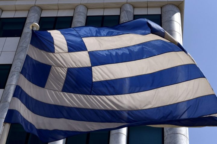 2015-08-03 14:07:14 A Greek flag is pictured outside the Athens Stock Exchange in Athens on August 3, 2015. Greece's stock exchange reopened August 3 with a drop of more than 22 percent after a five-week shutdown imposed by the country's debt crisis and capital controls, with the nation's outflow-hit lenders leading the way. The ATHEX plunged to 615.72 points a few minutes after opening at 0730 GMT, down 22.82 percent from its June 26 close. AFP PHOTO / ARIS MESSINIS