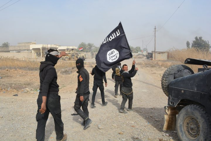 "2015-01-26 13:19:21 Iraqi government forces celebrate while holding an al-Qaeda affiliated flag after they claimed they have gained complete control of the Diyala province, northeast of Baghdad, on January 26, 2015 near the town of Muqdadiyah. Iraqi forces have ""liberated"" Diyala province from the Islamic State jihadist group, retaking all populated areas of the eastern region, a top army officer said today. The symbolic victory for Baghdad, which has at times struggled to push IS back, could clear the way for further advances against the jihadists . AFP PHOTO / YOUNIS AL-BAYATI"