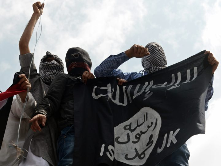 """2014-07-18 20:00:31 (FILES) In this photogaph taken on July 18, 2014, Kashmiri demonstrators hold up a flag of the Islamic State of Iraq and the Levant (ISIL) during a demonstration against Israeli military operations in Gaza, in downtown Srinagar. Al-Qaeda launched a new branch to """"wage jihad"""" in South Asia as it sought September 4, 2014 to invigorate its waning Islamist extremist movement, but experts said it would struggle to gain traction with India's Muslims. Al-Qaeda once attracted jihadists from around the world to training camps on the Afghan-Pakistan border, but has seen its global influence eclipsed by the Islamic State (IS) jihadist group fighting in Iraq and Syria. AFP PHOTO/Tauseef MUSTAFA/FILES"""