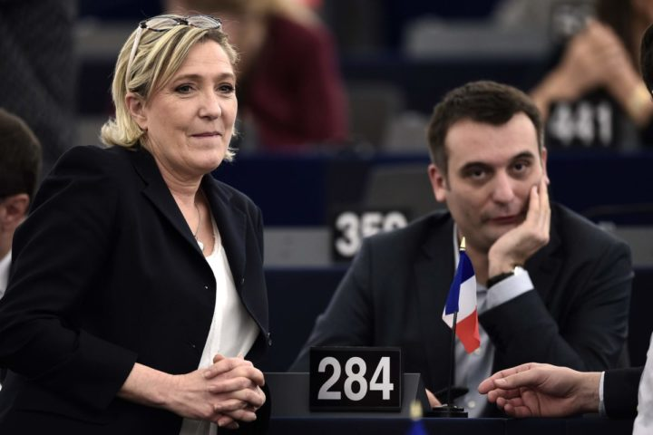 2017-01-17 14:04:27 French Front National (National Front - FN) far-right party's President, European MP and presidential candidate for the 2017 election Marine Le Pen (L) stands next to FN vice-president Florian Philippot take part in a plenary session of the European Parliament marking the election of its new President in Strasbourg, eastern France, on January 17, 2016. The European Parliament elects a new president today in a vote that promises to be stormy after a coalition aimed at keeping eurosceptics out of power broke down / AFP PHOTO / FREDERICK FLORIN