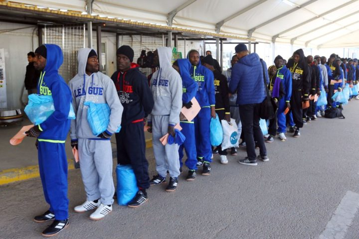 2017-02-14 10:11:01 Nigerian migrants who were being held at a detention centre in Tripoli after entering Libya illegally, stand in line at Mitiga International Airport before being deported on February 14, 2017. The migrants were repatraited in coordination with the International Organization for Migration. / AFP PHOTO / MAHMUD TURKIA