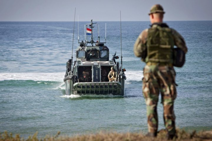 "2015-10-23 00:00:00 epa04991666 Some Dutch soldiers take part in an exercise as part of the NATO drill 'Trident Juncture' in Sierra del Retin, Cadiz, southern Spain, 23 October 2015. The troops have to ""liberate"" a country invaded by ""an enemy"" after the ficticious country had asked for help to NATO. Trident Juncture is the Alliance's largest military exercise for over a decade that involves 36,000 troops from more than 30 countries and takes place in Italy, Spain and Portugal. EPA/ROMAN RIOS"
