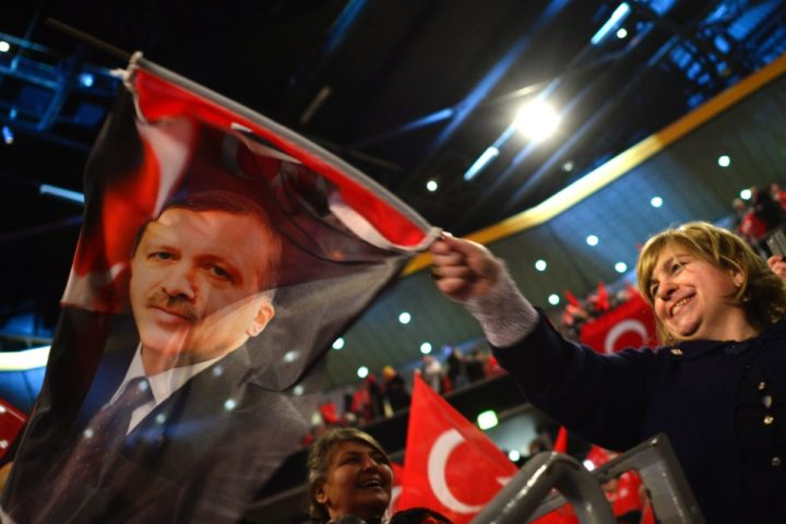 2017-02-18 13:46:17 People wave Turkish flags during a campaigning event with the Turkish President in Oberhausen, western Germany, on February 17, 2017. Turkish Prime Minister Binali Yildirim speaks to an expected crowd of some 10,000 people of Turkish origin in Germany to promote support for an April 16, 2017 constitutional referendum on expanding President Recep Tayyip Erdogan's powers. / AFP PHOTO / Sascha Schuermann