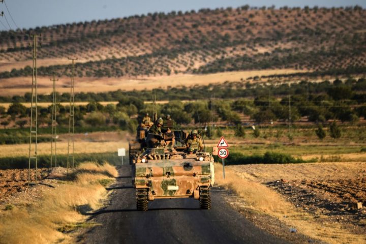 2016-09-02 12:08:39 Turkish soldiers stand in a Turkish army tank driving back to Turkey from the Syrian-Turkish border town of Jarabulus on September 2, 2016 in the Turkish-Syrian border town of Karkamis. Turkish military experts on September 1, 2016 cleared mines from the area of the Syrian town of Jarabulus captured from jihadists last week, using controlled explosions that sent clouds of dust and smoke into the sky, an AFP photographer said. Pro-Ankara Syrian rebels, backed by Turkish aviation and tanks, took Jarabulus from Islamic State (IS) fighters in a lightning operation and now enjoy full control of the town. / AFP PHOTO / BULENT KILIC